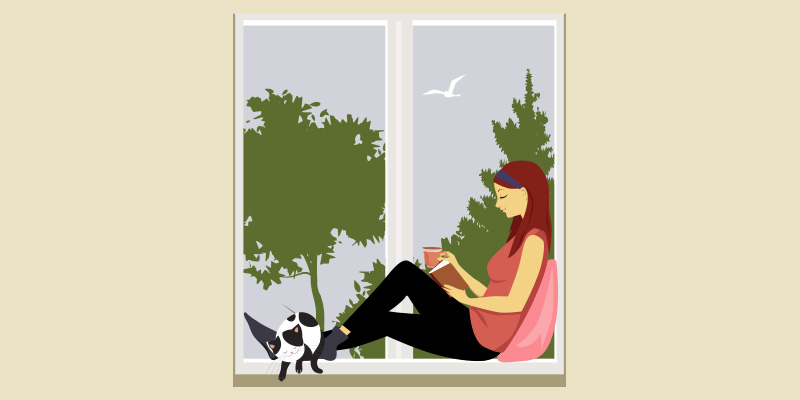 Woman sitting peacefully at window